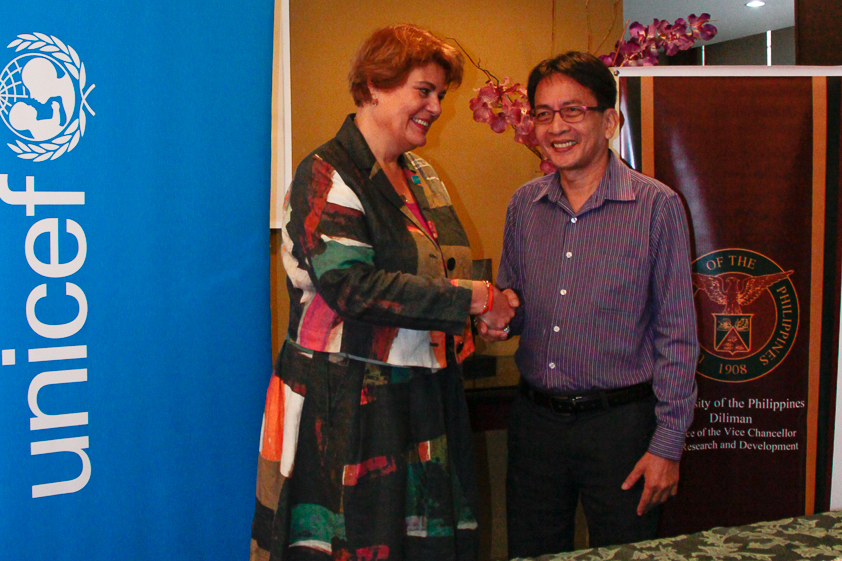 UNICEF Philippines Representative Ms. Lotta Sylwander and UP Diliman Chancellor Michael Tan shake hands after signing the Agreement last 20 January 2015.